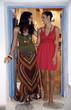 Two young women in art gallery doorway
