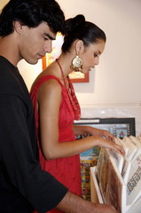 Young couple looking through artwork