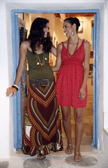 Two young women in art gallery doorway