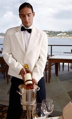 Waiter displaying wine bottle