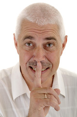 Senior man with silence gesture