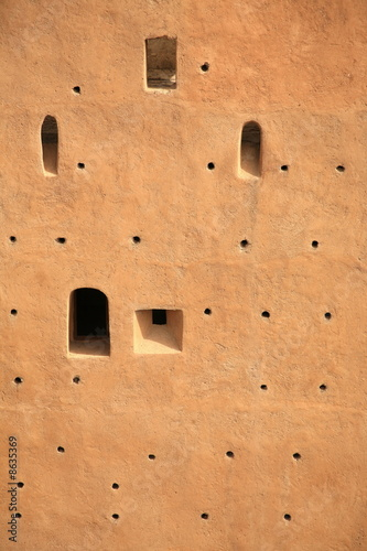 Closeup of building wall with holes