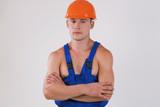 worker in blue uniform and helmet poster