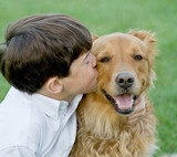 Little Boy Kissing Dog