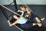 Woman Working Out With Personal Trainer poster
