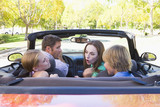 Family in convertible car arguing