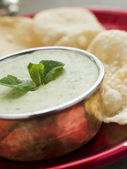 Fresh Green Yoghurt Chutney with mini Papadoms