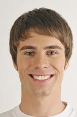 """""""Young male adult face;smiling"""""""