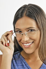 Female young adult looking over eyeglasses