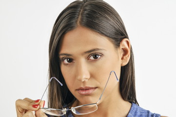 Female young adult removing eyeglasses