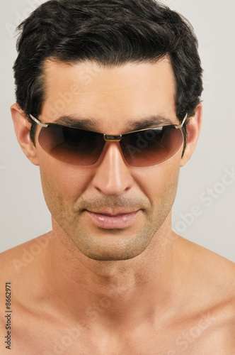 Young male adult wearing sunglasses