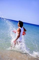 Man splashing through water