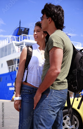 Young couple at ferry dock