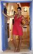 Young woman in art gallery doorway
