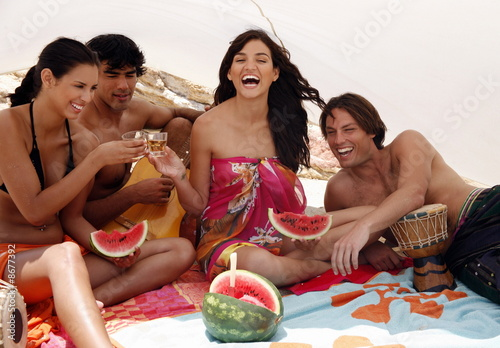 Two couples on beach having fun