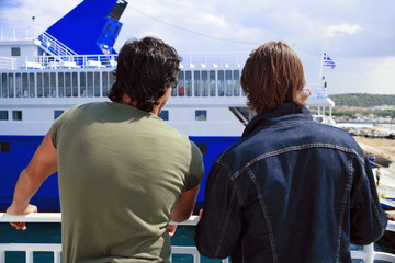 Two men on ferry at dock