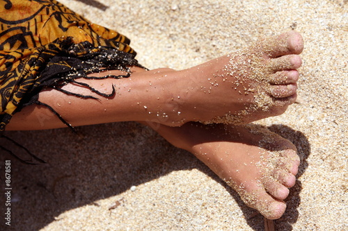 Woman's bare feet on sand