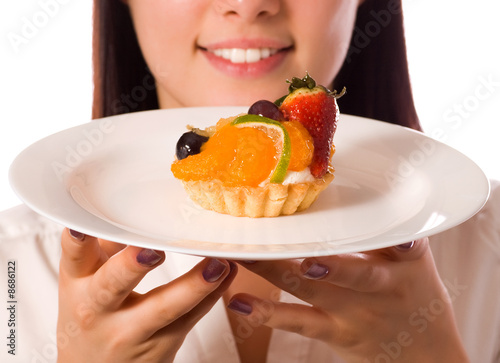 poster of young woman with low-calorie fruit cake (focus on cake)