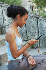 Beautiful young teenager reading a text message