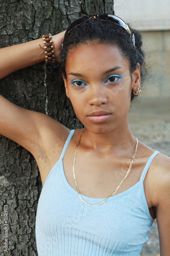 A beautiful attractive African girl  outdoors in sunshine