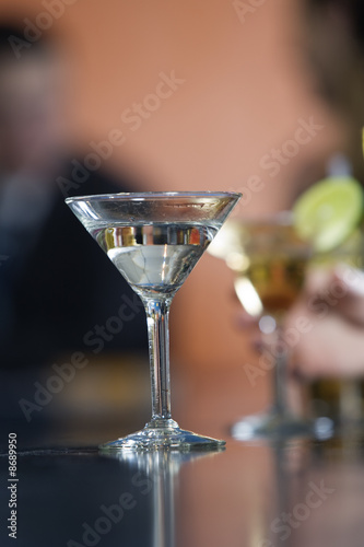Close up of glasses filled with cocktail on a bar counter.