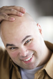 Portrait of a bald headed man smiling .
