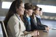 Business women sitting in an office.