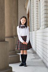 elementary schoolgirl in school uniform