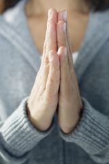 Close up of a woman praying.
