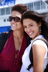 Two young women posing in front of ferry