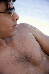 Closeup of young man on beach