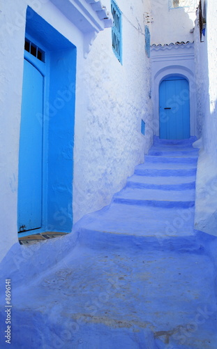 Blue steps leading to door