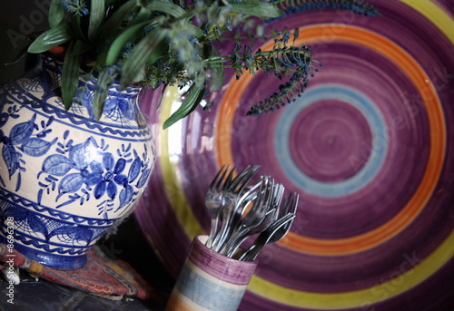 Closeup of vase;plate;and cup with forks