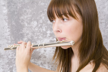 Teenager girl playing flute
