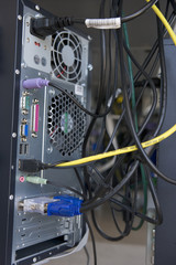 Shot of many cables in the back of a computer modem