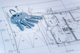 blue tone image of keys over some technical drawing poster