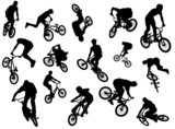 Black silhouettes of bmx and mtb riders poster