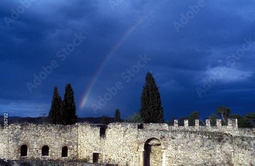 Rainbow over old stone building