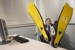 Office worker at desk wearing swim flippers