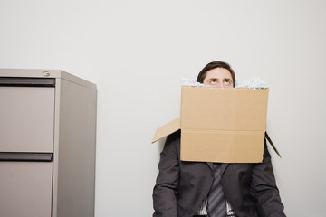 Office worker with head in a box