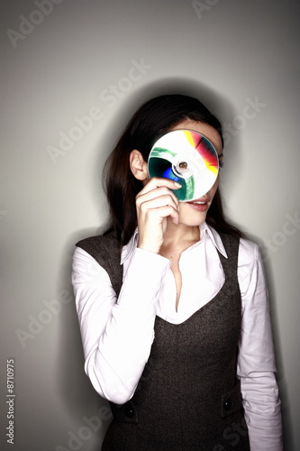 Office worker looking through CD hole