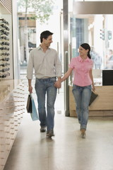 Couple entering sunglasses store