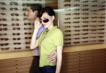 Couple shopping in sunglasses store