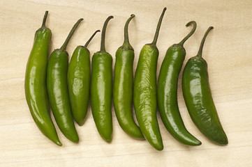 Green chili peppers in row