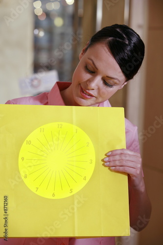 Woman holding optical chart