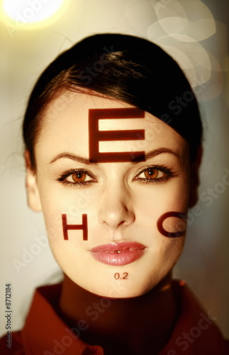 Woman with optical exam characters on her face