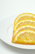 Sliced orange on plate, close-up