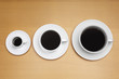 Three coffee cups of various sizes