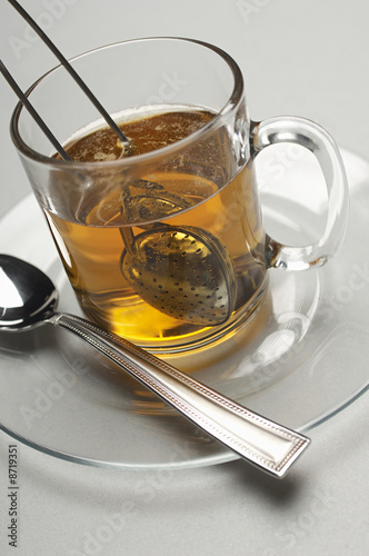 Glass with tea strainer inside, close-up