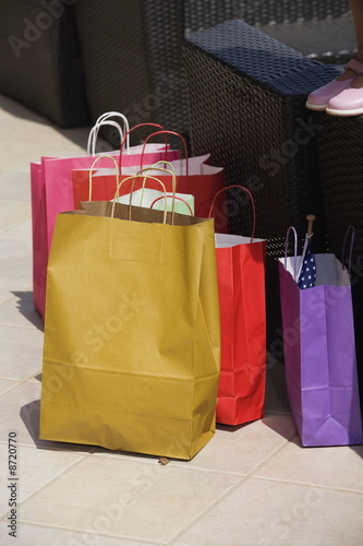 Shopping bags and little girl's feet